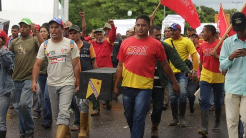A march of campesinos in Barinas city demand justice for the local community leaders gunned down by landlords in recent months, carrying a symbolic coffin